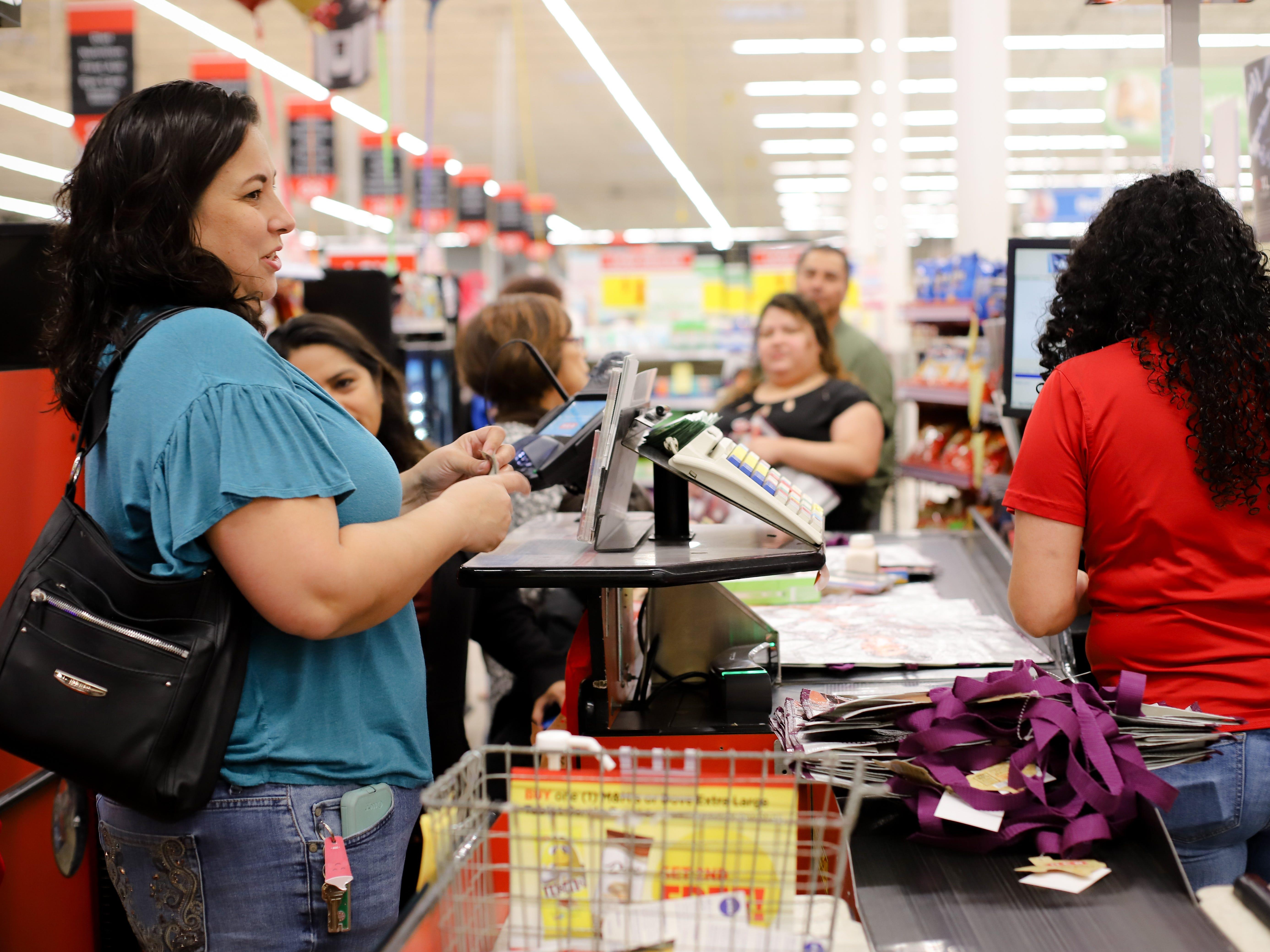 Corpus Christi Rita Thomas buys Selena reusable bags at the H-E-B Plus on Saratoga Boulevard in Corpus Christ on Dec. 6, 2018.