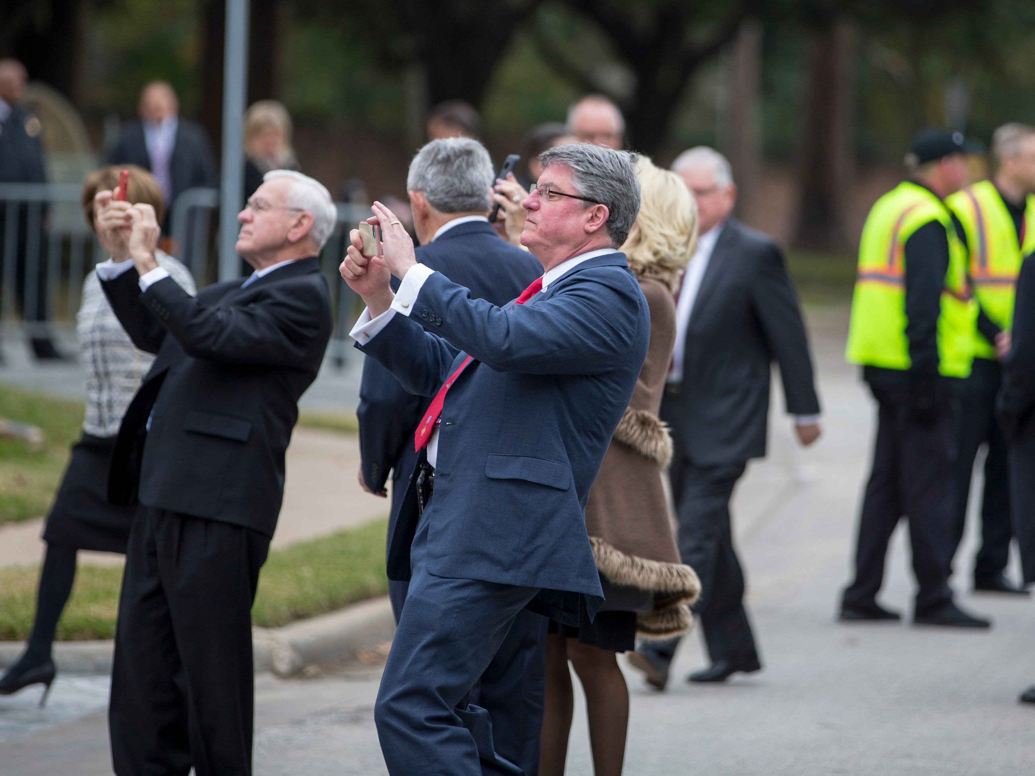 People take photos as they arrive at the church for former President George H.W. Bush's funeral service on Thursday, Dec. 6, 2018, at St. Martin's Episcopal Church in Houston, which is where he and former First Lady Barbara Bush worshiped for more than 50 years.