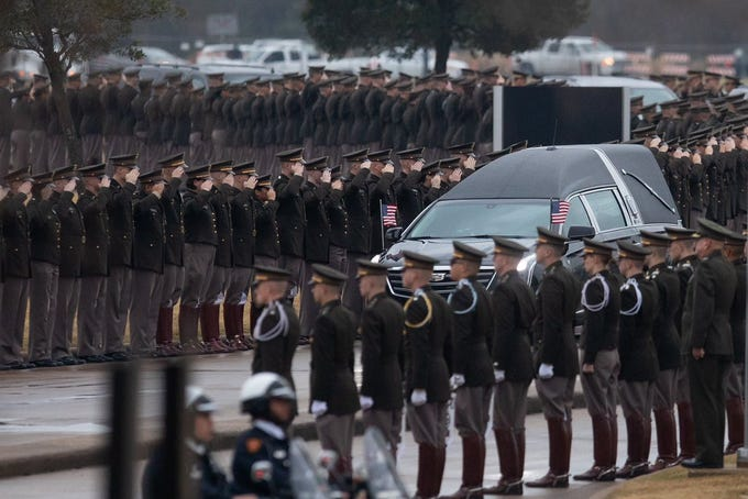 Texas A&M cadets salute the hearse carrying George H.W. Bush, the 41st president of the United States as it  arrives at the George Bush Presidential Library & Museum in College Station on Thursday, Dec. 6, 2018.