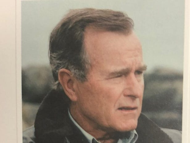 This memorial card was handed out to mourners on Wednesday, Dec. 5, 2018, at St. Martin's Episcopal Church in Houston, Texas. It was the site of the repose for former president George H.W. Bush.