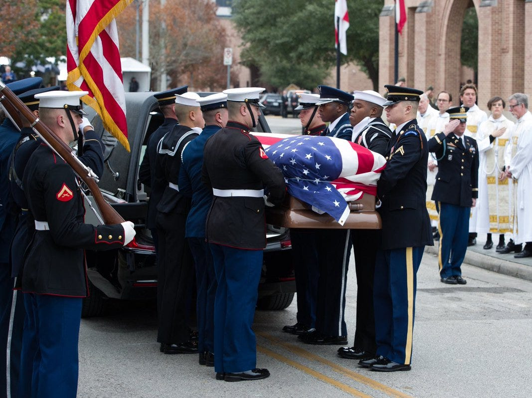 U.S. Service Members with the Ceremonial Honor Guard carry the casket of former President George H.W. Bush into a hearse following the funeral service on Thursday, Dec. 6, 2018, at St. Martin's Episcopal Church in Houston, Texas.