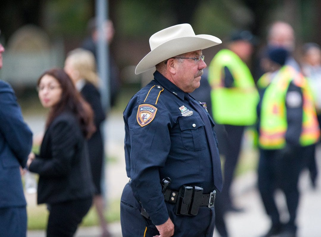 A Harris County sheriff's deputy patrols the grounds of St. Martin's Episcopal Church in Houston, Texas on Thursday, Dec. 6, 2018 ahead of the funeral service for former president George H.W. Bush.