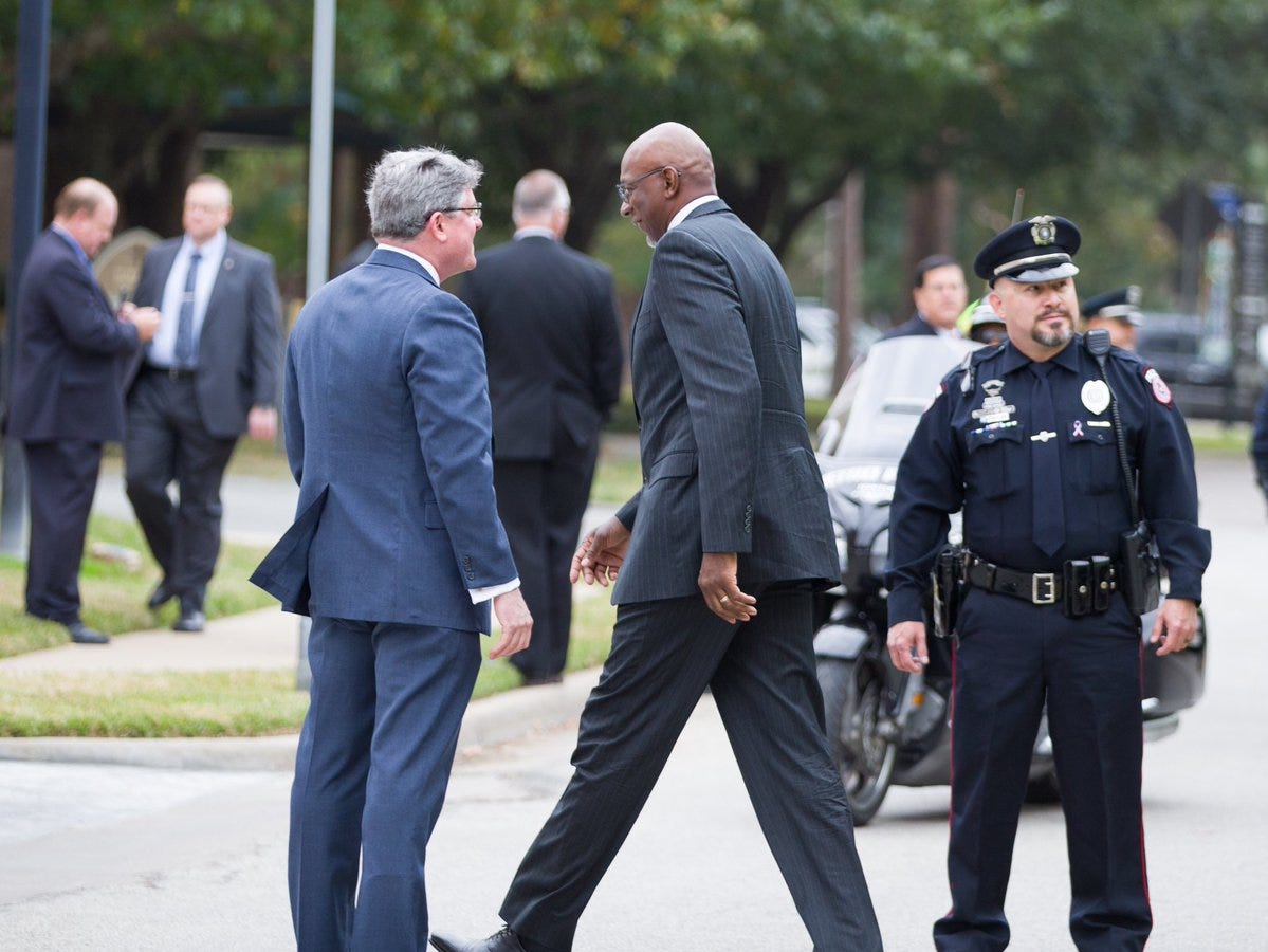 Former Houston Rockets great Clyde Drexler (center) arrives at St. Martin's Episcopal Church on Thursday, Dec. 6, 2018, for the funeral service for former President George H.W. Bush in Houston, Texas.