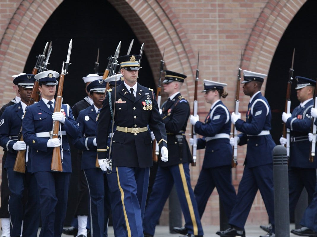 U.S. Service members with the Ceremonial Honor Guard stand outside St. Martin's Episcopal Church on Thursday, Dec. 6, 2018, for the funeral service of former President George H.W. Bush.