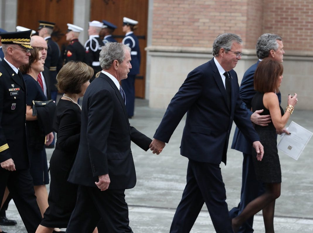 Former President George W. Bush (center) and brother and former Florida Gov. Jeb Bush leave St. Martin's Episcopal Church after the funeral service for their father, former President George H.W. Bush, on Thursday, Dec. 6, 2018, in Houston, Texas.