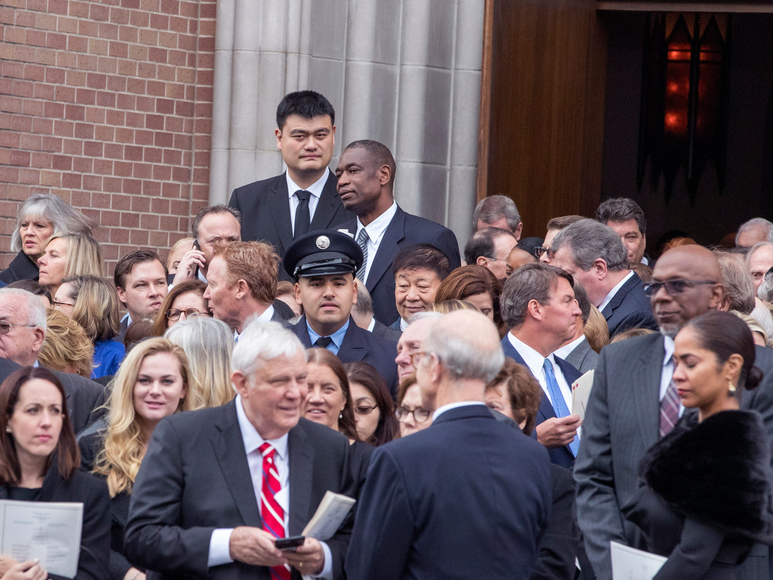 Former NBA players Yao Ming and Dikembe Mutombo (back row) attend the funeral service of former President George H.W. Bush on Thursday, Dec. 6, 2918, at St. Martin's Episcopal Church in Houston.