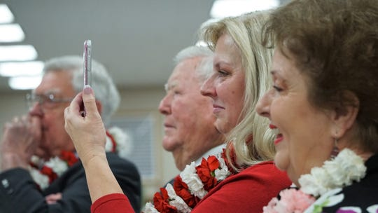 Thetis Neal, right, listens to her son, Loyd Neal III, speak during a retirement celebration honoring her husband, Nueces County Judge Loyd Neal, at the county courthouse on Dec. 6, 2018. To Thetis Neal's right is Ann Margaret Eddy, the couple's daughter.