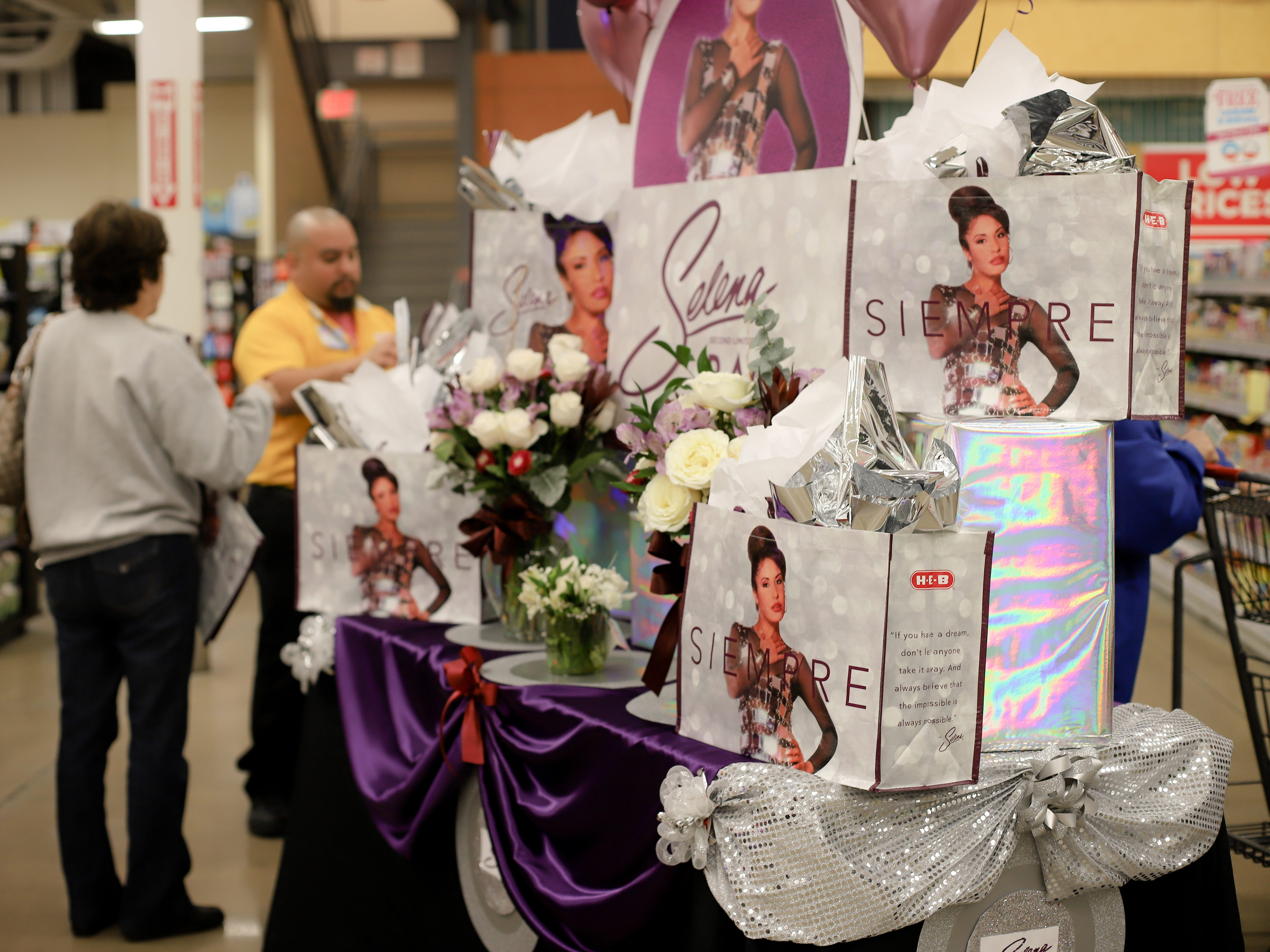 H-E-B employees had a table to display the Selena reusable bags on Dec. 6, 2018. Employees handed two bags to each customer.