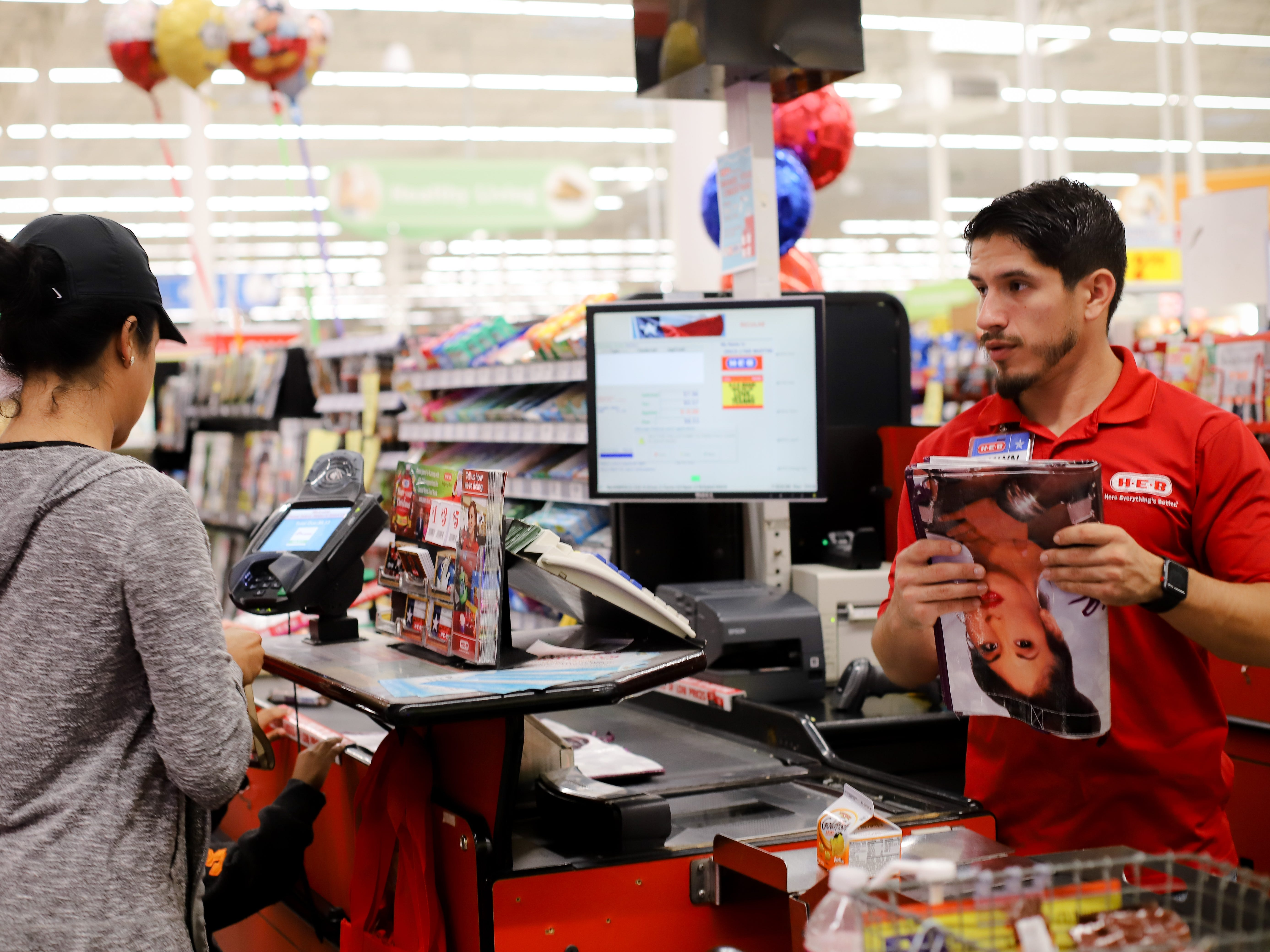An H-E-B customer buys the second-edition Selena reusable bag at the store on Saratoga Boulevard in Corpus Christi.