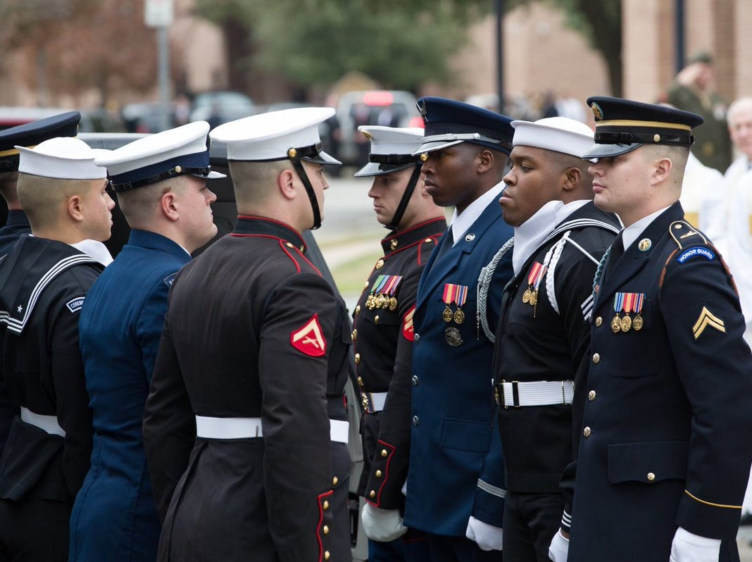 U.S. Service Members with the Ceremonial Honor Guard stand at attention following the funeral service for former President George H.W. Bush on Thursday, Dec. 6, 2018, at St. Martin's Episcopal Church in Houston, Texas.