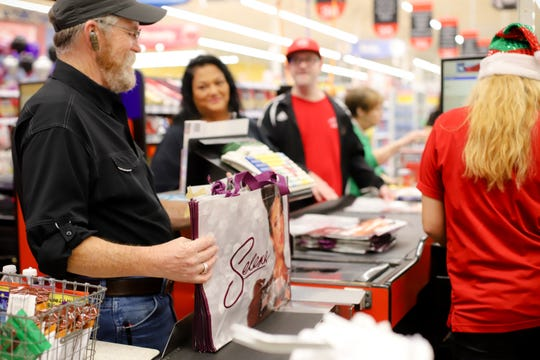 H-E-B customers lined up in designated checkout lines to purchase Selena reusable bags on Dec. 6, 2018.