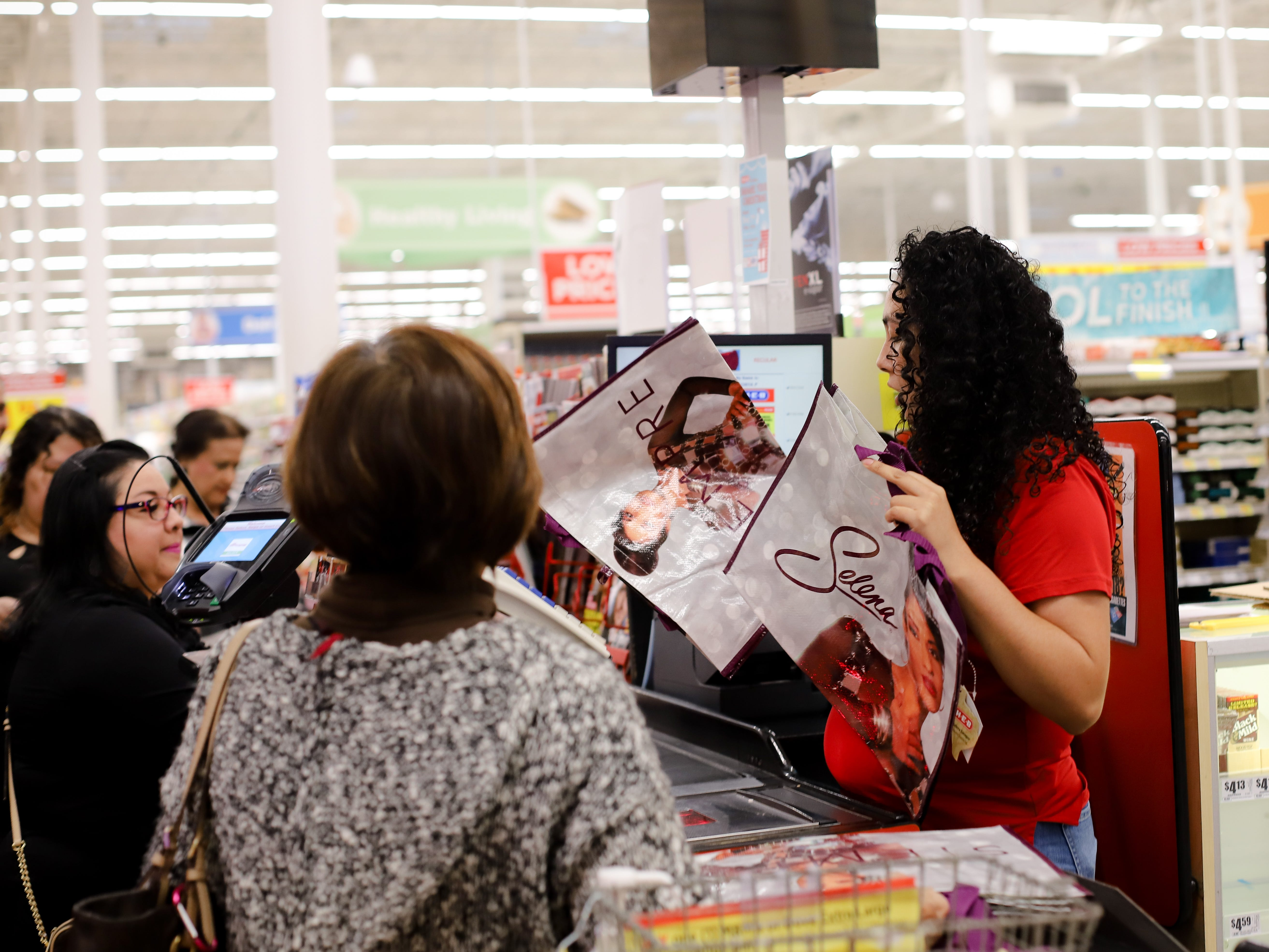 An H-E-B cashier scans Selena reusable bags at the store on Saratoga Boulevard in Corpus Christi on Dec. 6, 2018.