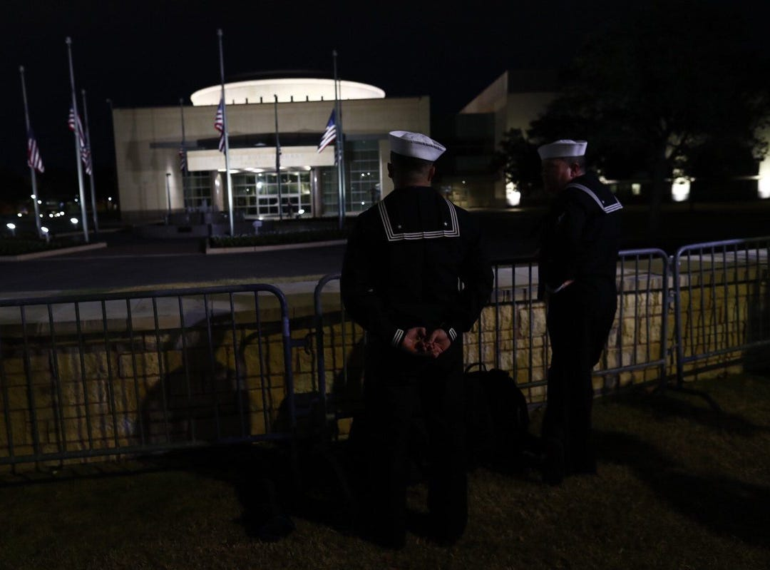 Two Navy service members stand guard on Thursday, Dec. 6, 2018, outside the George Bush Presidential Library and Museum in College Station, Texas.