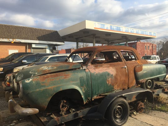 A rusting Studebaker sits at the former Monk's Amoco on Broadway in Camden, the site of multiple fuel spills.