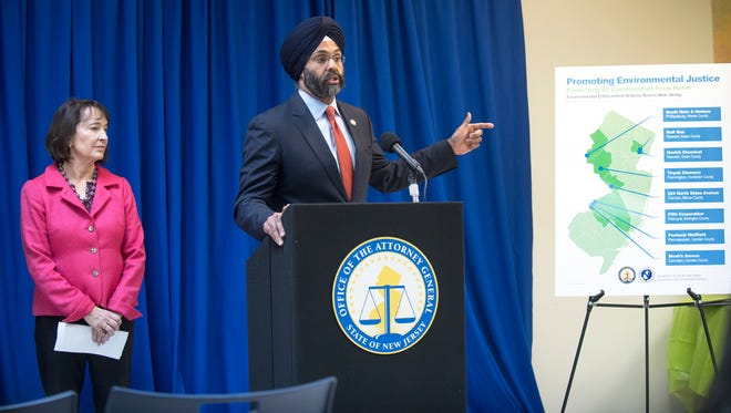 New Jersey Attorney General Gurbir S. Grewal discusses lawsuits across New Jersey targeting polluters in iower-income and minority communities, as State Department of Environmental Protection Commissioner Catherine McCabeas looks on, during a press conference held at Camden Lutheran Housing in Camden on Thursday, December 6, 2018.