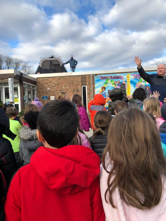 Richard Stockton Elementary School students greet teacher David Sonnheim before he spends the night on the roof of the school.