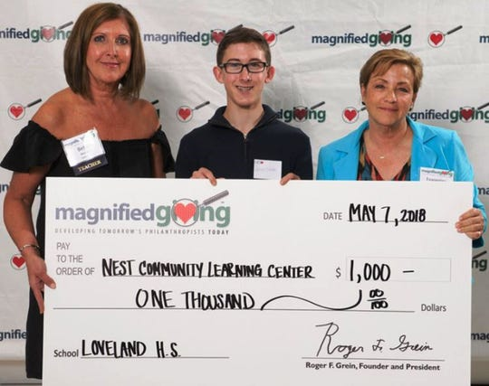 Loveland High School teacher Beth Wexler and NEST Community Learning Center founder Evangeline DeVol with an LHS student during Magnified Giving's award event last year.