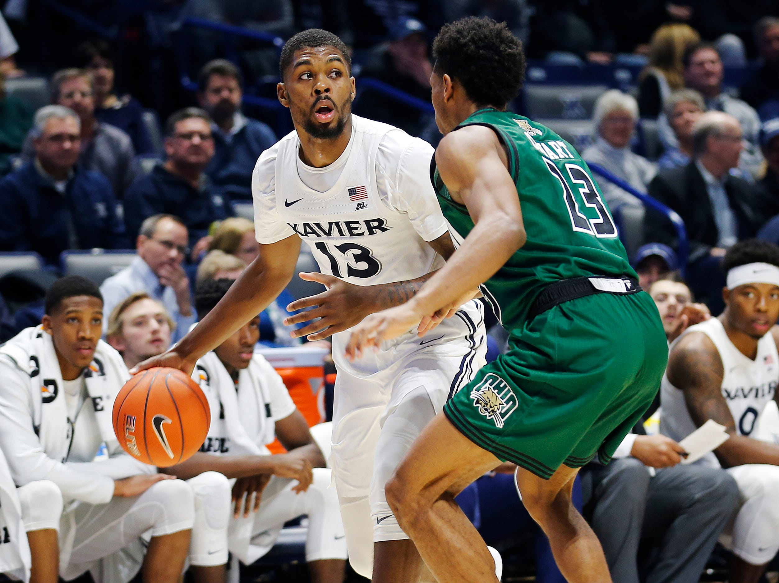 Xavier Musketeers forward Naji Marshall (13) looks to make a pass around Ohio Bobcats guard Antonio Cowart Jr. (23) in the second half at Cintas Center Wednesday December 5, 2018. Xavier won 82-61.