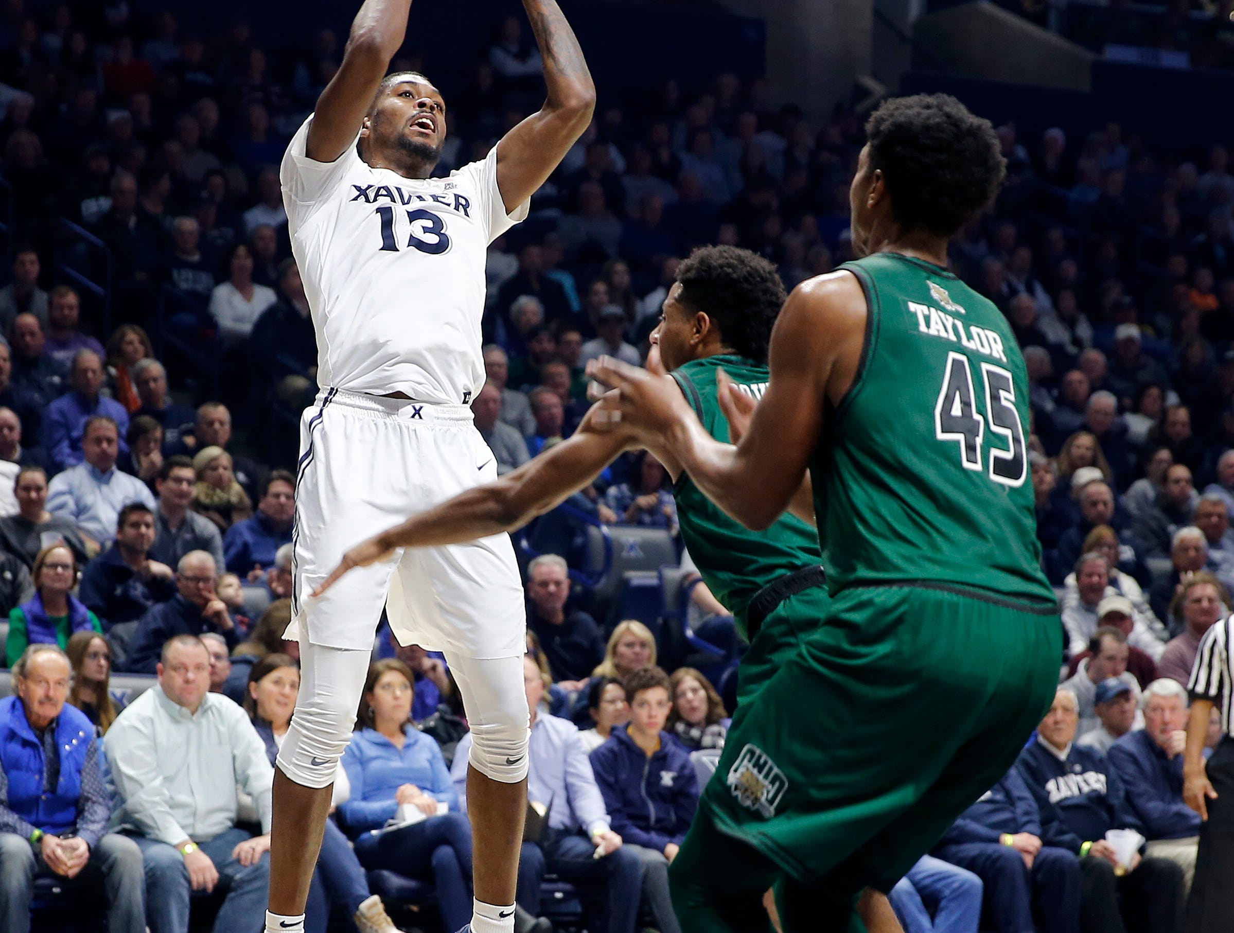 Xavier Musketeers forward Naji Marshall (13) shoots over the defense of Ohio University in the first half at Cintas  Center Wednesday December 5, 2018.