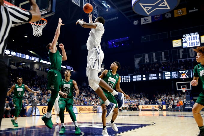 Xavier Musketeers forward Naji Marshall (13) goes for two over the Ohio Bobcats in the 2nd half at the Cintas Center December 5, 2018. Marshall scored 17 to help Xavier win 82-61.