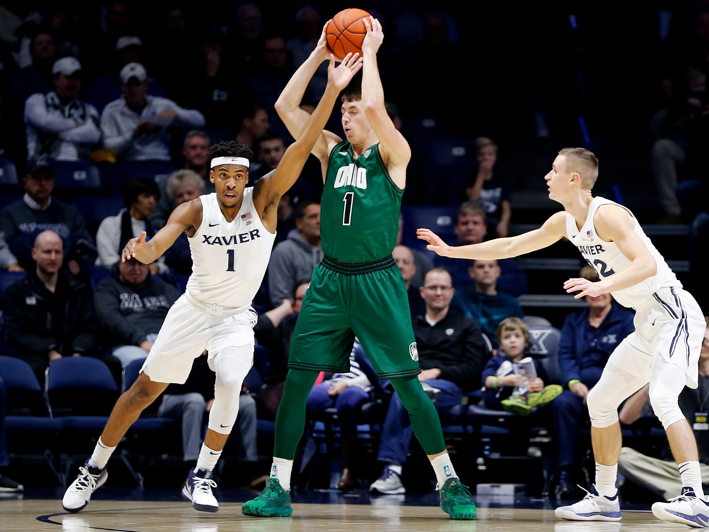 Xavier Musketeers guard Paul Scruggs (1), left, and Ryan Welage (32) double-team Ohio Bobcats forward Jason Carter (1) during the first halt at the Cintas Center December 5, 2018
