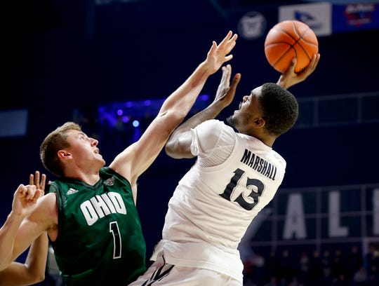 Johnstown graduate Jason Carter, shown here playing Xavier last December, is transferring to the school from Ohio University. Carter led the Bobcats with 16.5 points per game this season.