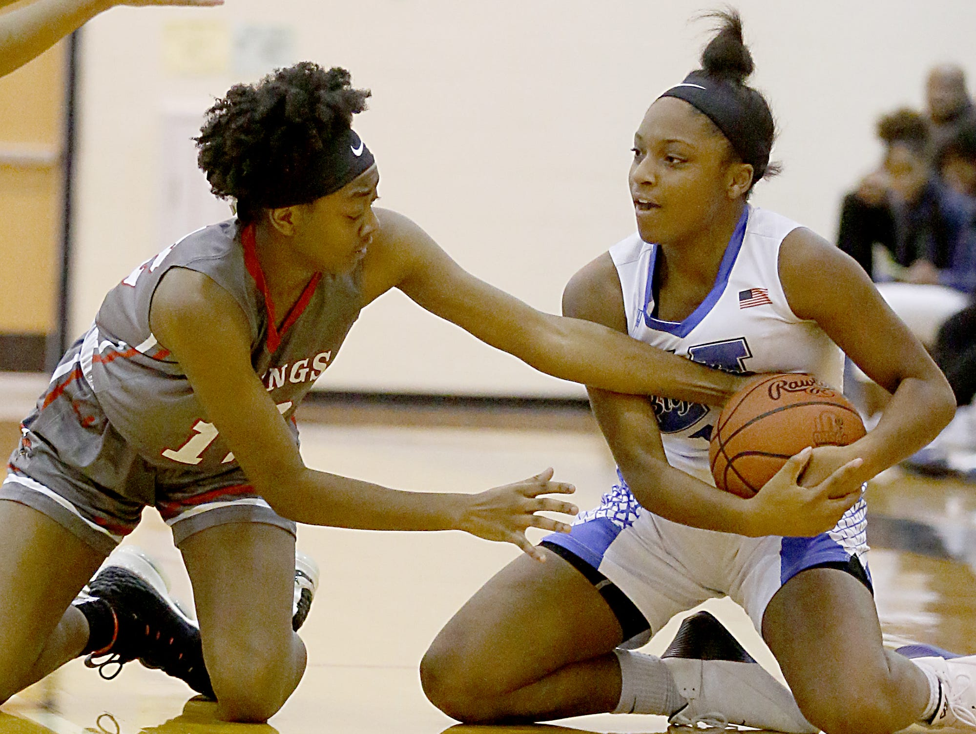 Hamilton forward Miracle Riggins hangs on to the ball as Princeton guard Madison Roshelle tries to steal during their game at Hamilton Wednesday, Dec. 5, 2018.