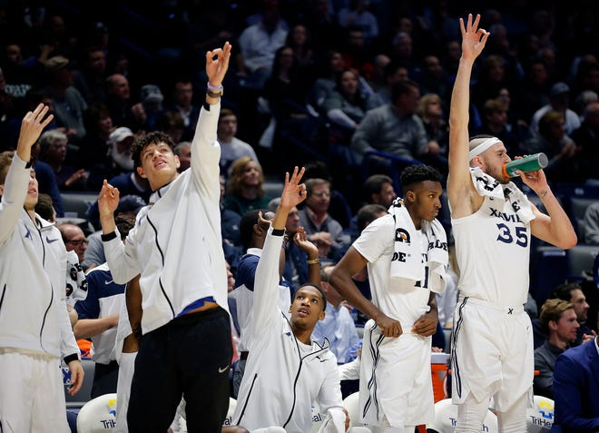 The Xavier bench celebrates after a 3-pointer by the Musketeers in the 2nd half at the Cintas Center Wednesday December 5, 2018. Xavier beat Ohio University 82-61.