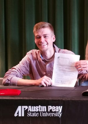 Houston County High School's Morgan Robinson proudly displays his letter of intent to play collegiate golf at Austin Peay State University.