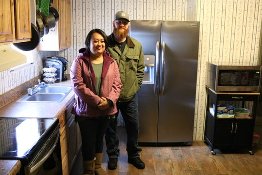 Michael and Crystal Burgeson with their new appliances, donated by Electrolux, at their Clarksville home on Thursday, Dec. 6, 2018.