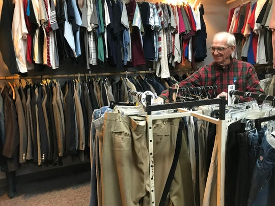PDI Thrift Store Manager LeRoy Parks sorts items in the men's clothing department. Men's clothes are especially needed because most clothing donated are for women and children.