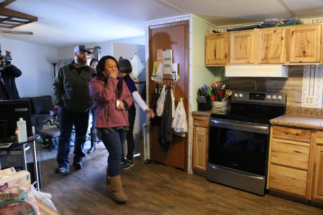 Michael and Crystal Burgeson see their new appliances, donated by Electrolux, at their Clarksville home on Thursday, Dec. 6, 2018.