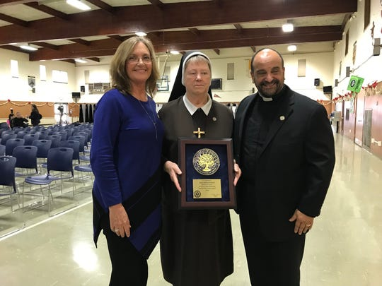 St. Helena School in Edison celebrated its recognition as a 2018 National Blue Ribbon School of Excellence with an assembly and the raising of the National Blue Ribbon flag. Pictured from left to right is Vice Principal Roberta Antorino, Principal Sister Mary Charles and the Rev. Anthony Sirianni, pastor of Saint Helena Church.