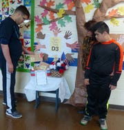 """PRDS students at the drop off station for the """"100,000 Thank You's"""" effort."""