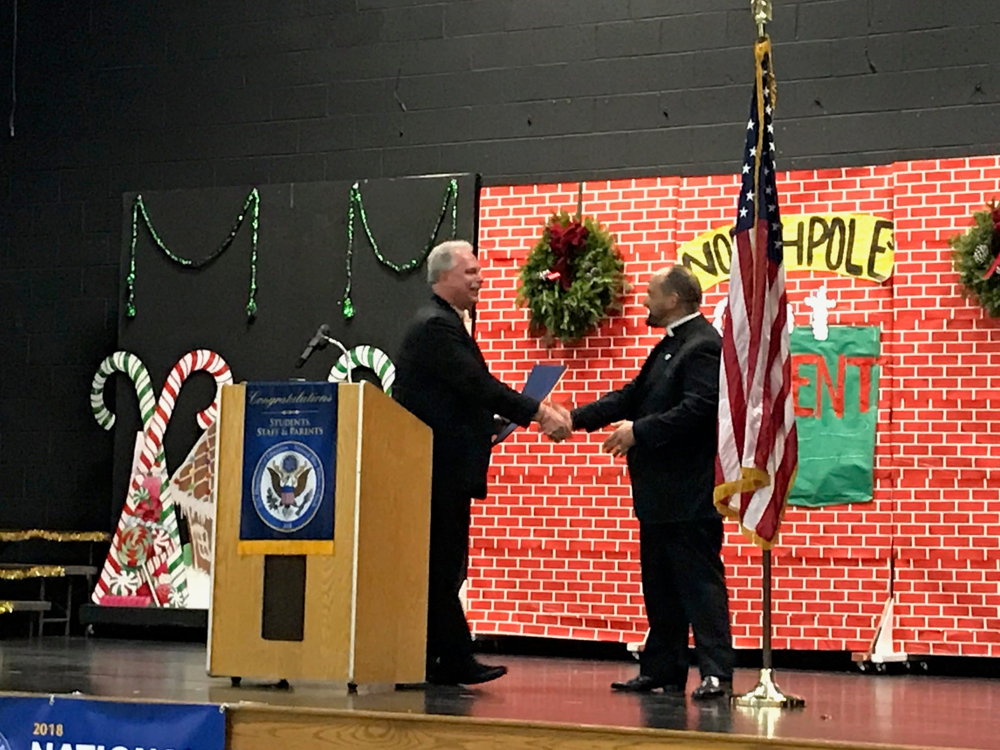 Edison Mayor Thomas Lankey addressed the group at Saint HelenaSchool in Edison, which celebration of its recognition as a 2018 NationalBlue Ribbon School.