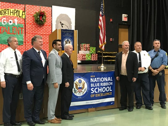 Several visitors helped Saint Helena School in Edison celebrate its recognition as a 2018 National Blue Ribbon School of Excellence at an assembly and the raising raising ceremony on Thursday.