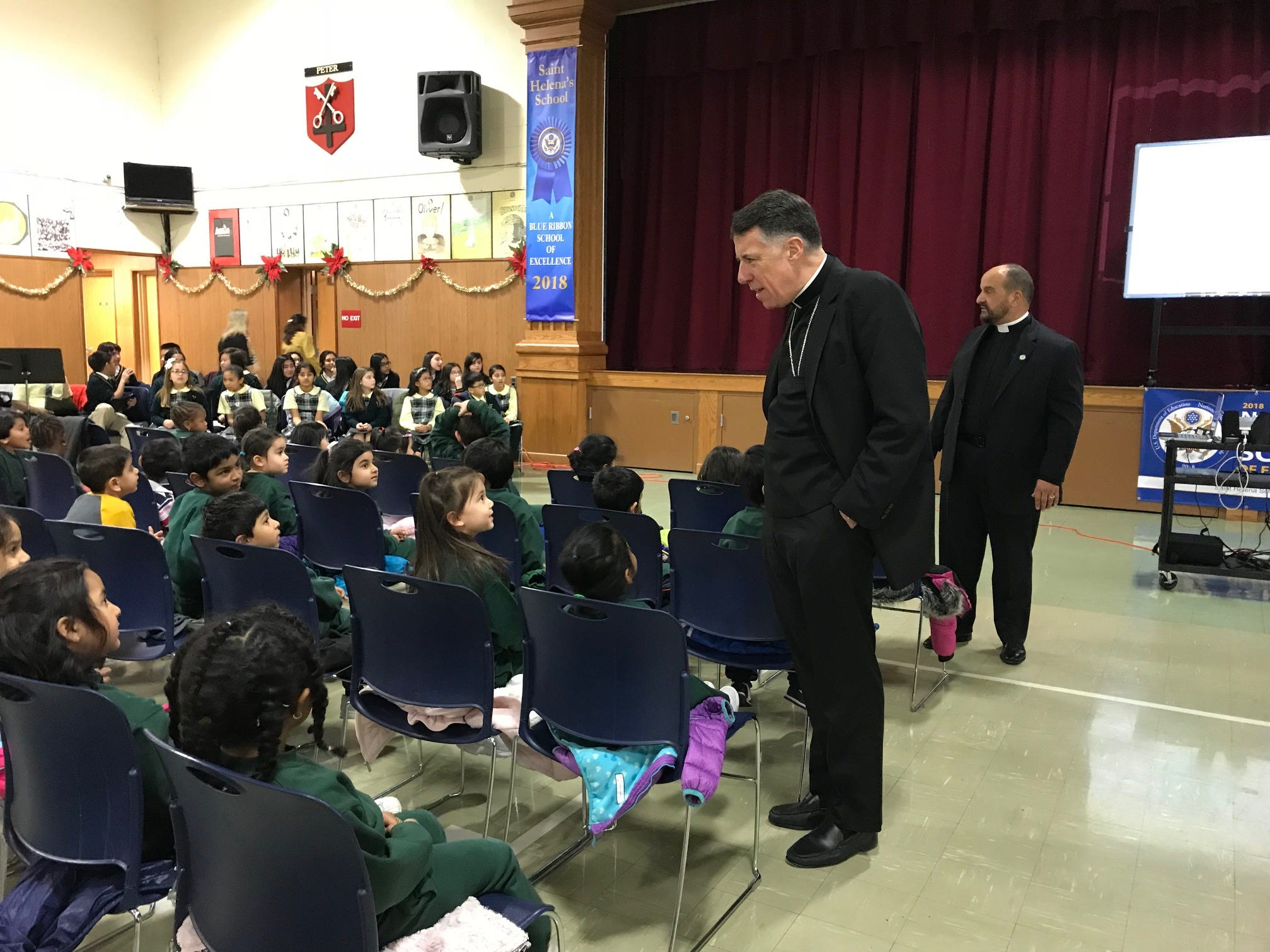 Diocese of Metuchen Bishop James Checchio chats with students at Saint HelenaSchool in Edison during the school's celebration of its 2018 NationalBlue Ribbon School award.