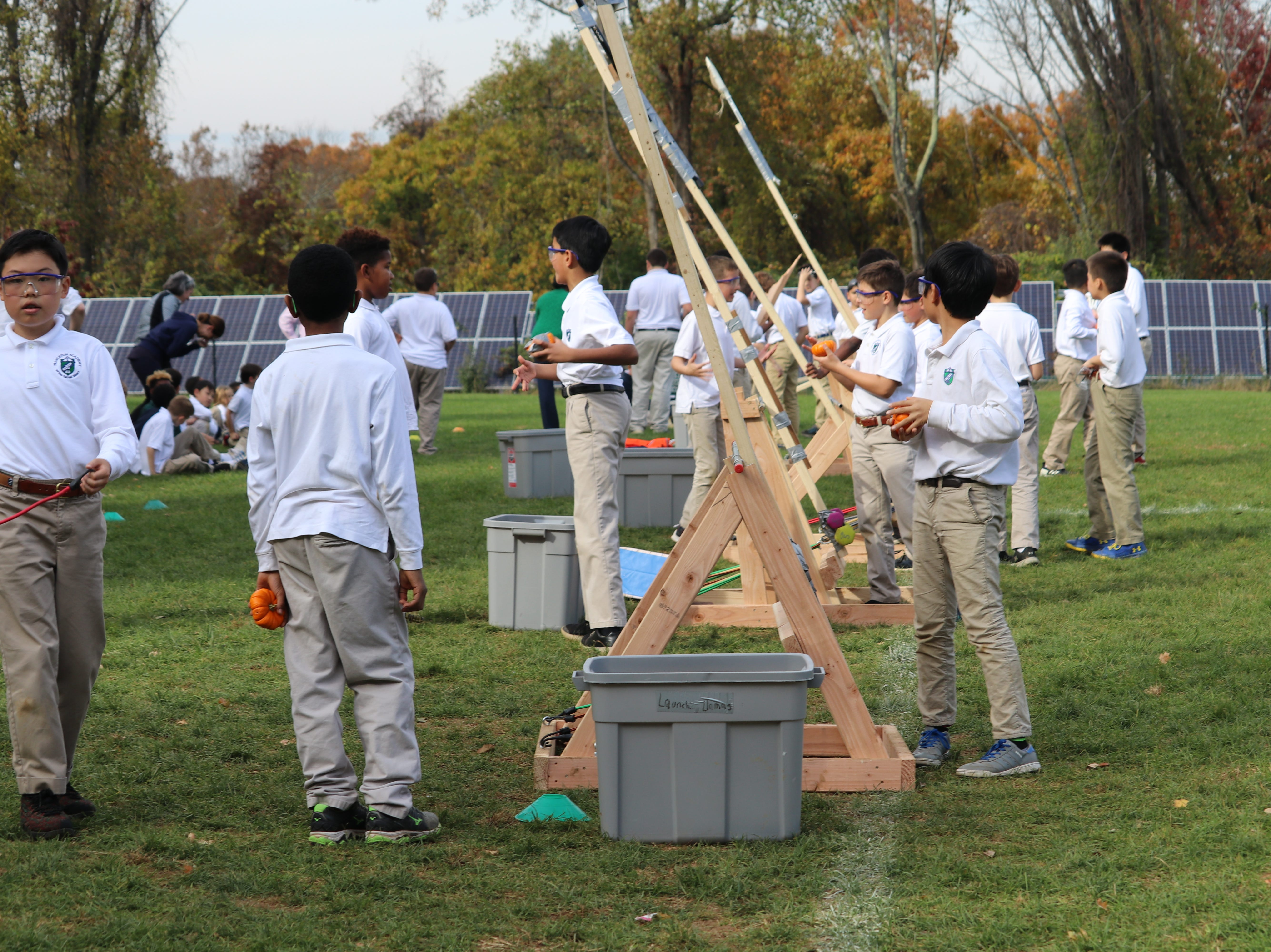 Princeton Academy of the Sacred Heart fifth-graders designed and built catapults to launch mini-pumpkins in a school competition.