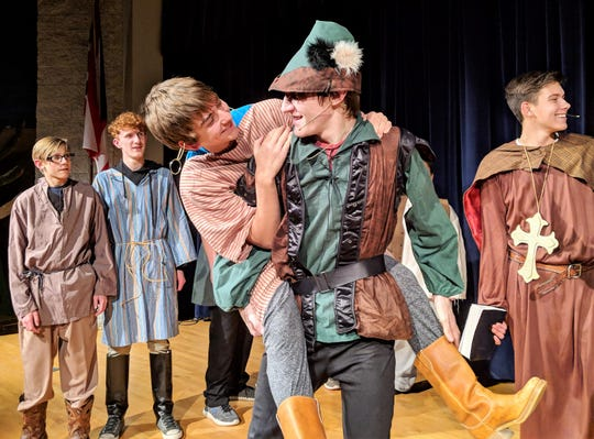 "Dakota Walters, Zade Adkins, Ryan Moses, Trevor Hawkins and Daniel Scott rehearse a scene from ""The Somewhat True Tale of Robin Hood"" opening Thursday at Ridgewood High School."