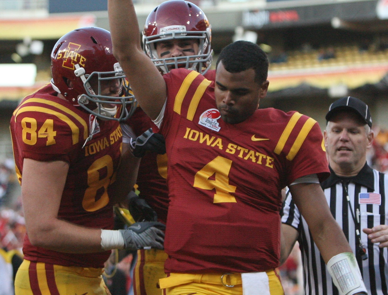 ISU's Austen Arnaud celebrates the Cyclone's first touchdown with his teammates. S0101ISUBowl -Iowa State University played Minnesota in the Insight Bowl in Tempe, Arizona, Thursday, December 31, 2009 at Sun Devil Stadium. (Andrea Melendez/The Register)