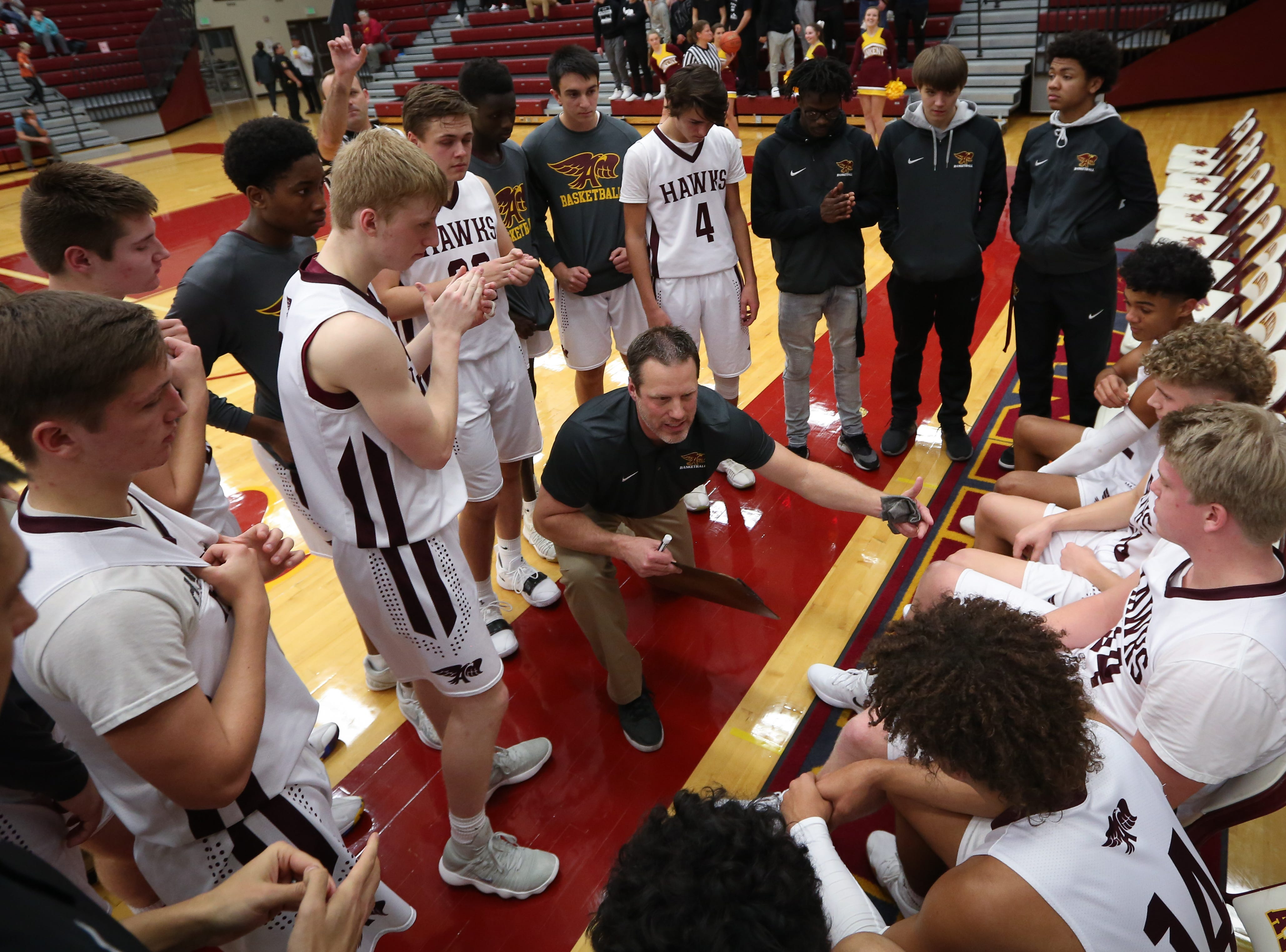 Ankeny head coach Bradnt Carlson gives instructions to his players during a boys high school basketball game between the Lincoln Railsplitters and the Ankeny Hawks at Ankeny High School on Dec. 4, 2018 in Ankeny, Iowa.