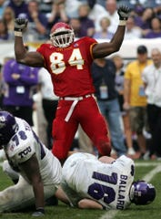 The Cyclones' Jason Berryman celebrates a sack of TCU quarterback Jeff Ballard during the 2005 Houston Bowl.