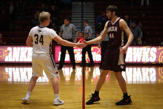 Ankeny junior Nolan Otten shakes hands with Lincoln senior Logan Sharp before a boys high school basketball game between the Lincoln Railsplitters and the Ankeny Hawks at Ankeny High School on Dec. 4, 2018 in Ankeny, Iowa.