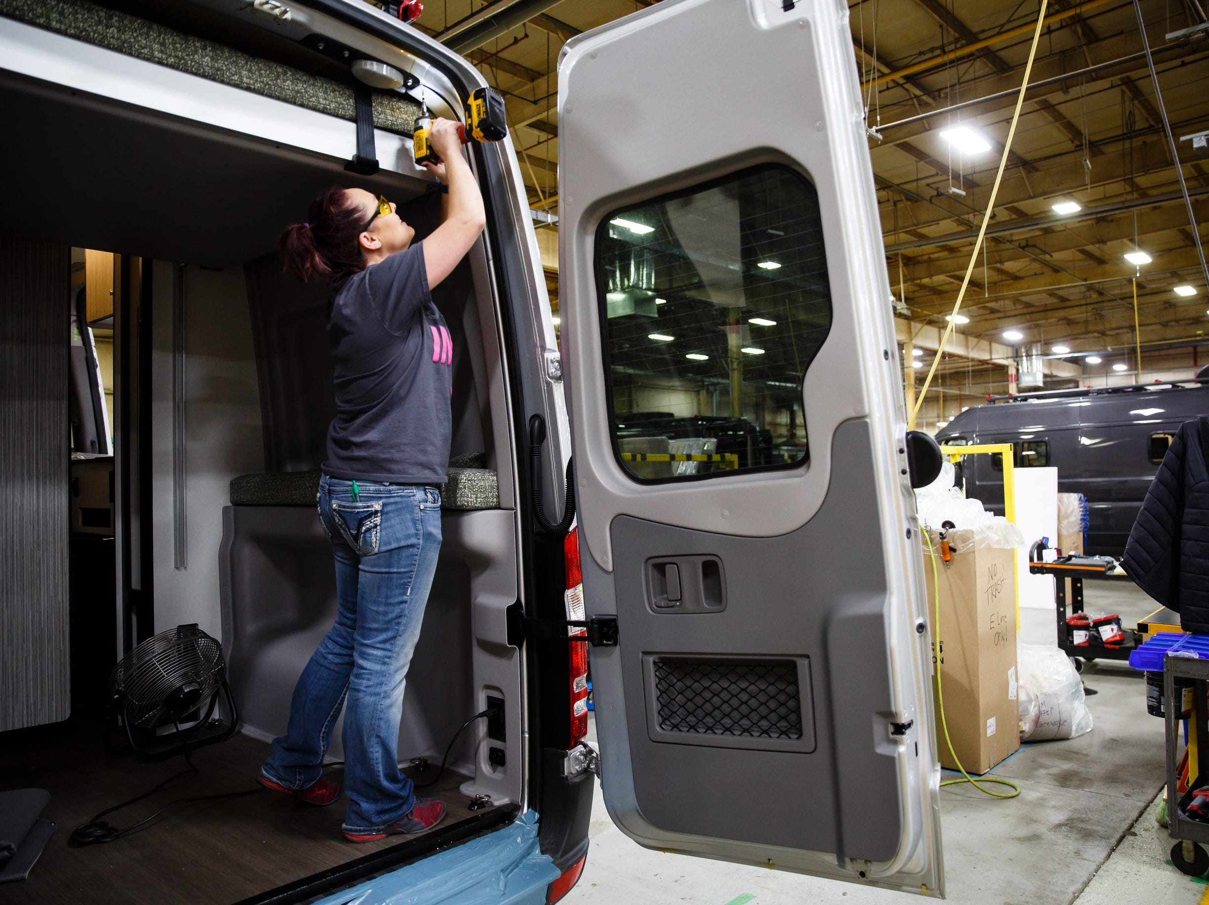 Workers install the moving bed frame on the Winnebago Revel at the companies Lake Mills factory on Wednesday, Dec. 5, 2018. The Revel, with its 4x4 and rugged nature has sparked the interest of outdoor enthusiasts and has helped the motor home manufacture rebound from poor sales during the recession.