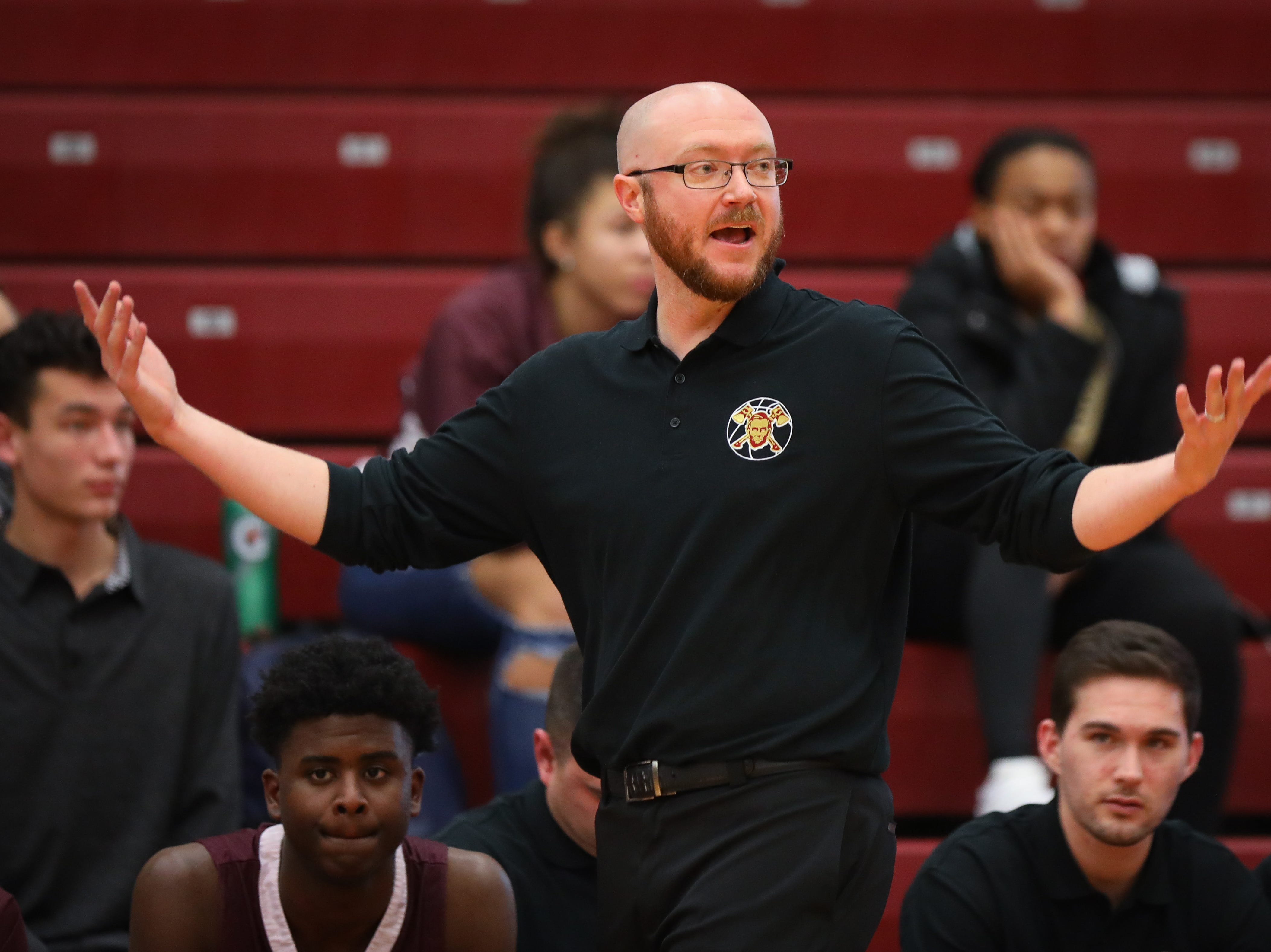 Lincoln head coach Justin Einerson complains about a call during a boys high school basketball game between the Lincoln Railsplitters and the Ankeny Hawks at Ankeny High School on Dec. 4, 2018 in Ankeny, Iowa.