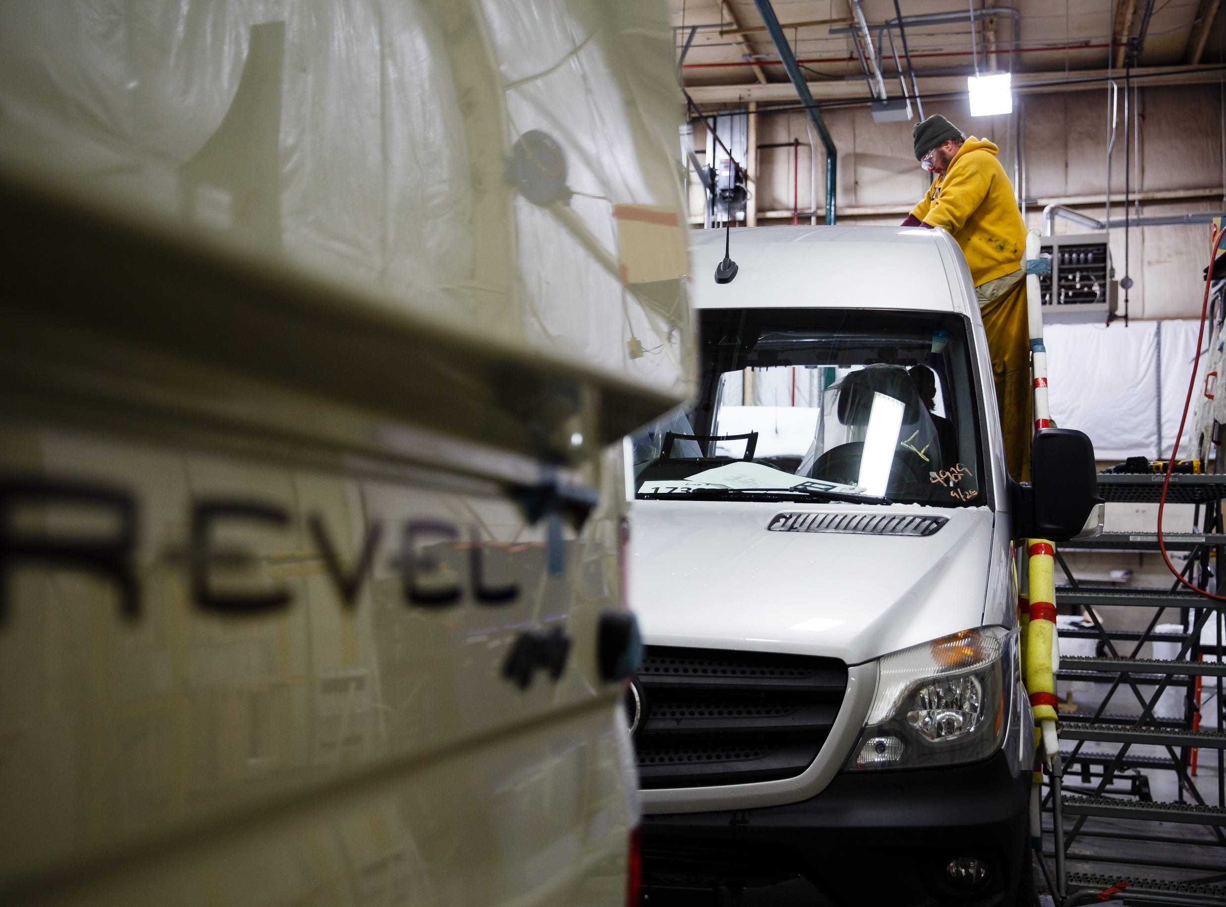 Workers make cutouts for various roof mounted accessories on the Winnebago Revel at the companies Lake Mills factory on Wednesday, Dec. 5, 2018. The Revel, with its 4x4 and rugged nature has sparked the interest of outdoor enthusiasts and has helped the motor home manufacture rebound from poor sales during the recession.