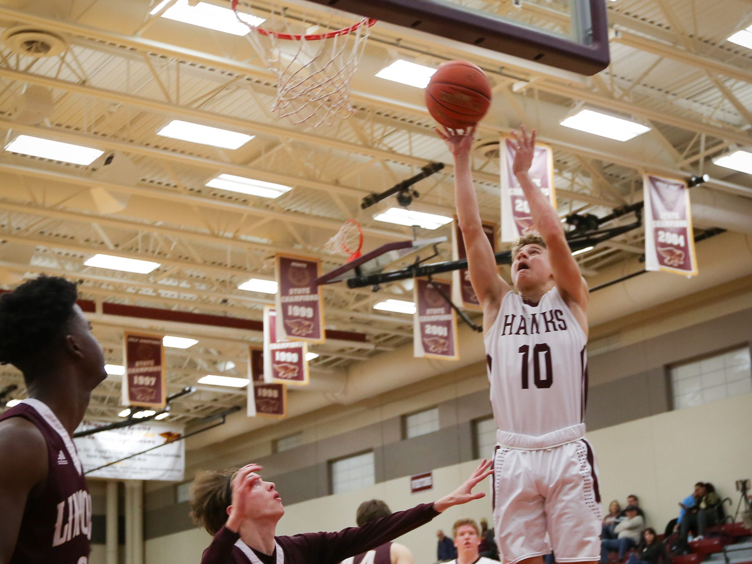Ankeny junior Jordan Kumm sinks a basket during a boys high school basketball game between the Lincoln Railsplitters and the Ankeny Hawks at Ankeny High School on Dec. 4, 2018 in Ankeny, Iowa.