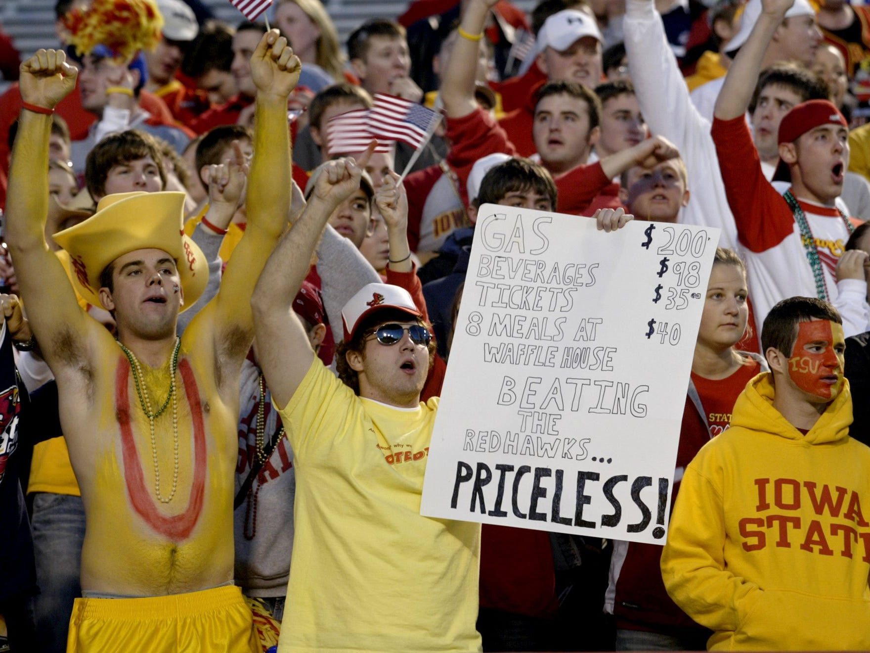 Iowa State University students Derick Tallman and Cory Hart, both of Ankeny, root on the Cyclones against Miami of Ohio during the 2004 Independence Bowl.