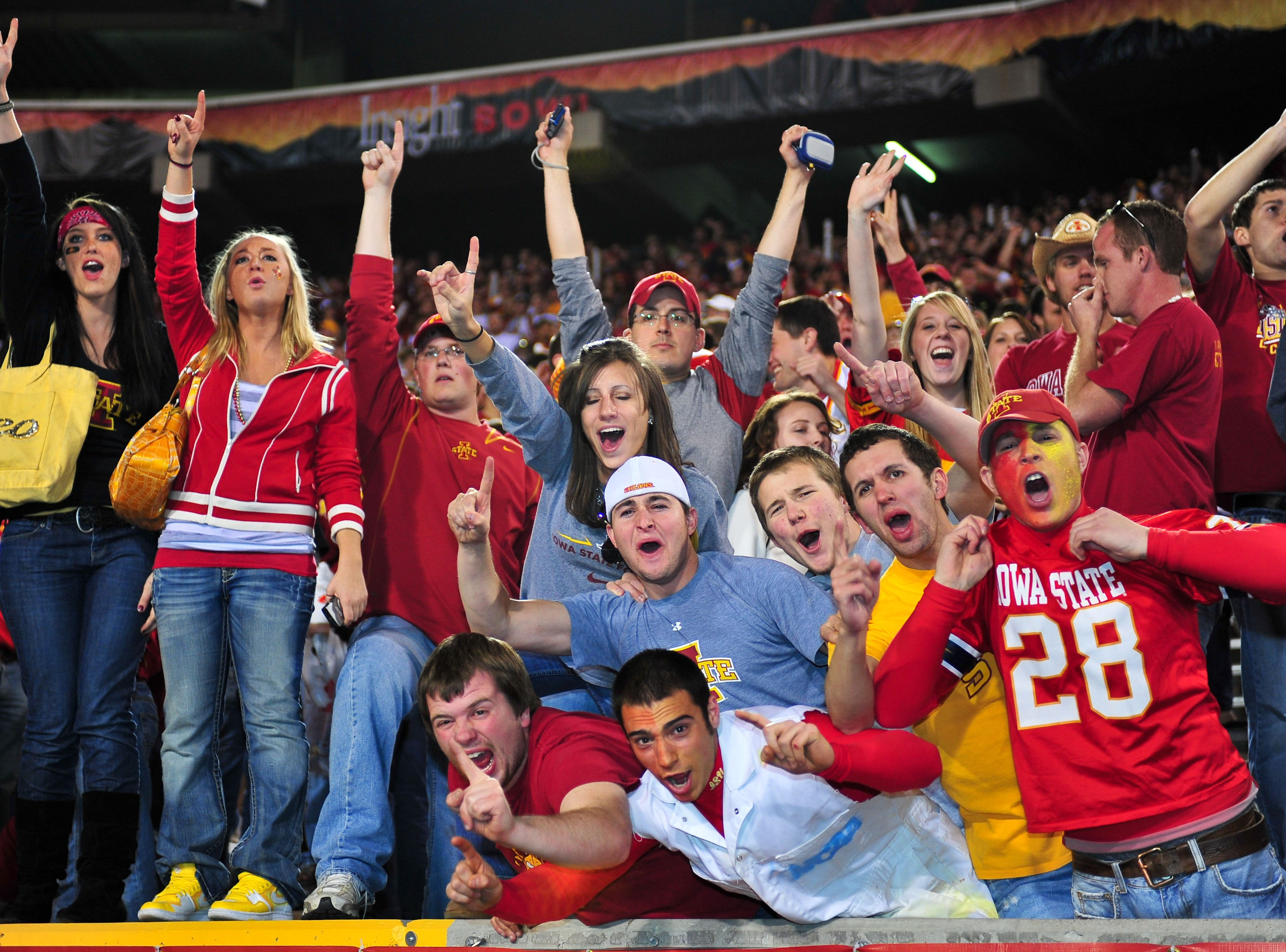 Dec 31, 2009; Tempe, AZ, USA; Iowa State Cyclones fans celebrate their team's 14-13 victory over the Minnesota Golden Gophers in the 2009 Insight Bowl at Sun Devil Stadium.  Mandatory Credit: Chris Morrison-USA TODAY Sports