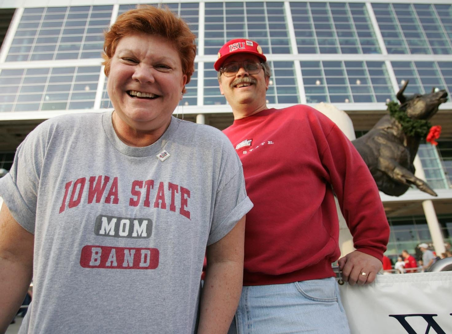 Proud parents: Dirk Brinkmeyer and wife Diane are shown in Houston, Texas, to see son Grant play in Iowa State's band at the 2005 Houston Bowl.